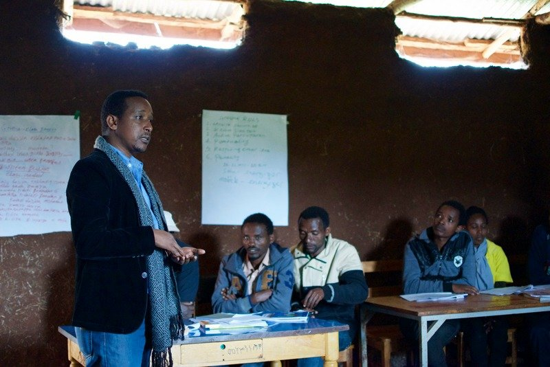 Nuru Specialist Getachew Abebe gives feedback to the training participants at Fite Primary School (teaching center for Zefine Cluster).