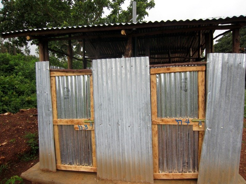 The superstructure of a completed latrine at a Nuru Ethiopia partner school