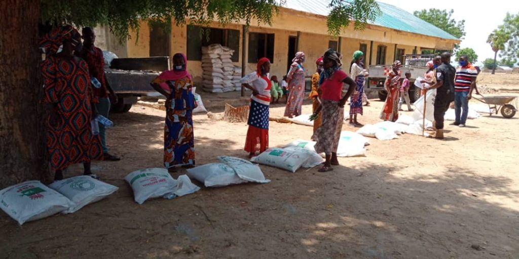 women waiting with crop packages