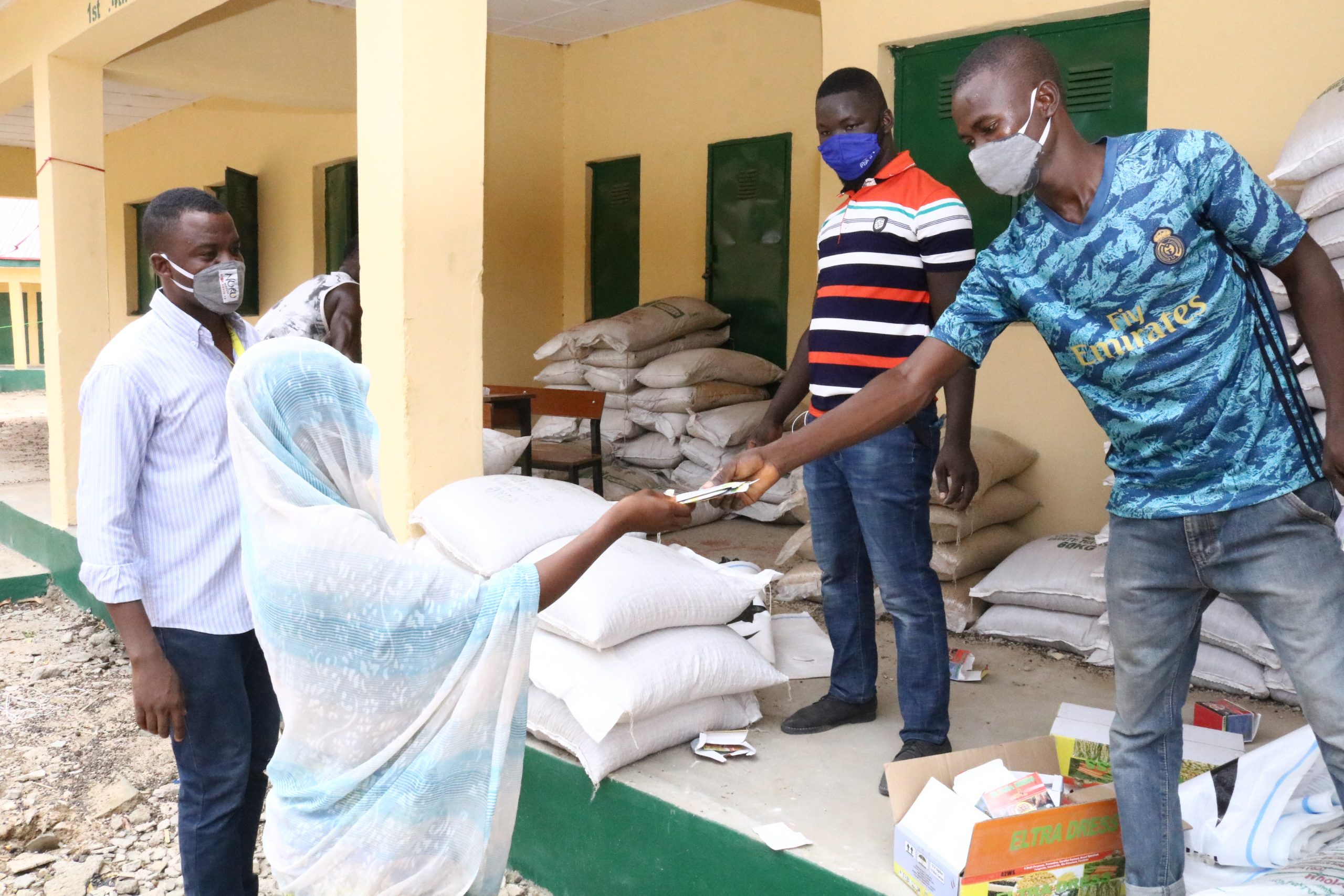 crop packages being distributed to woman