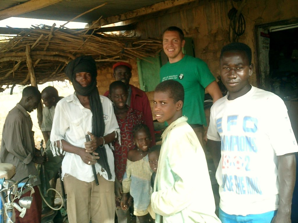 man standing with group of people in Burkina Faso