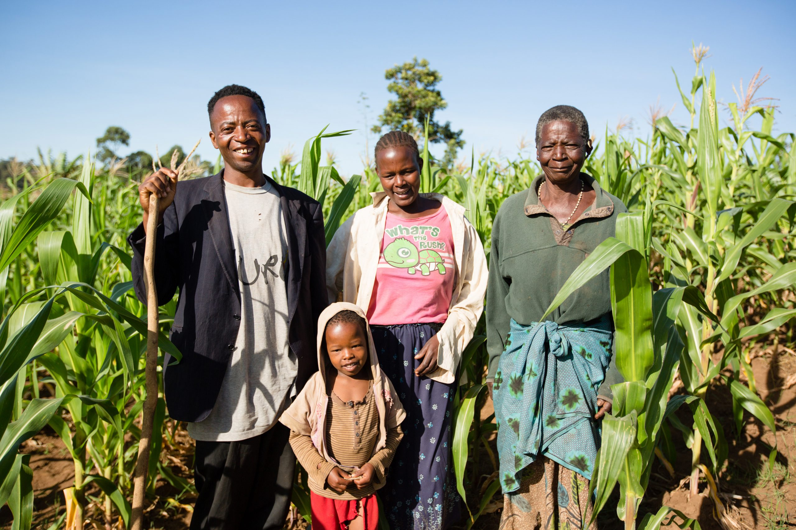Kenyan family standing in field