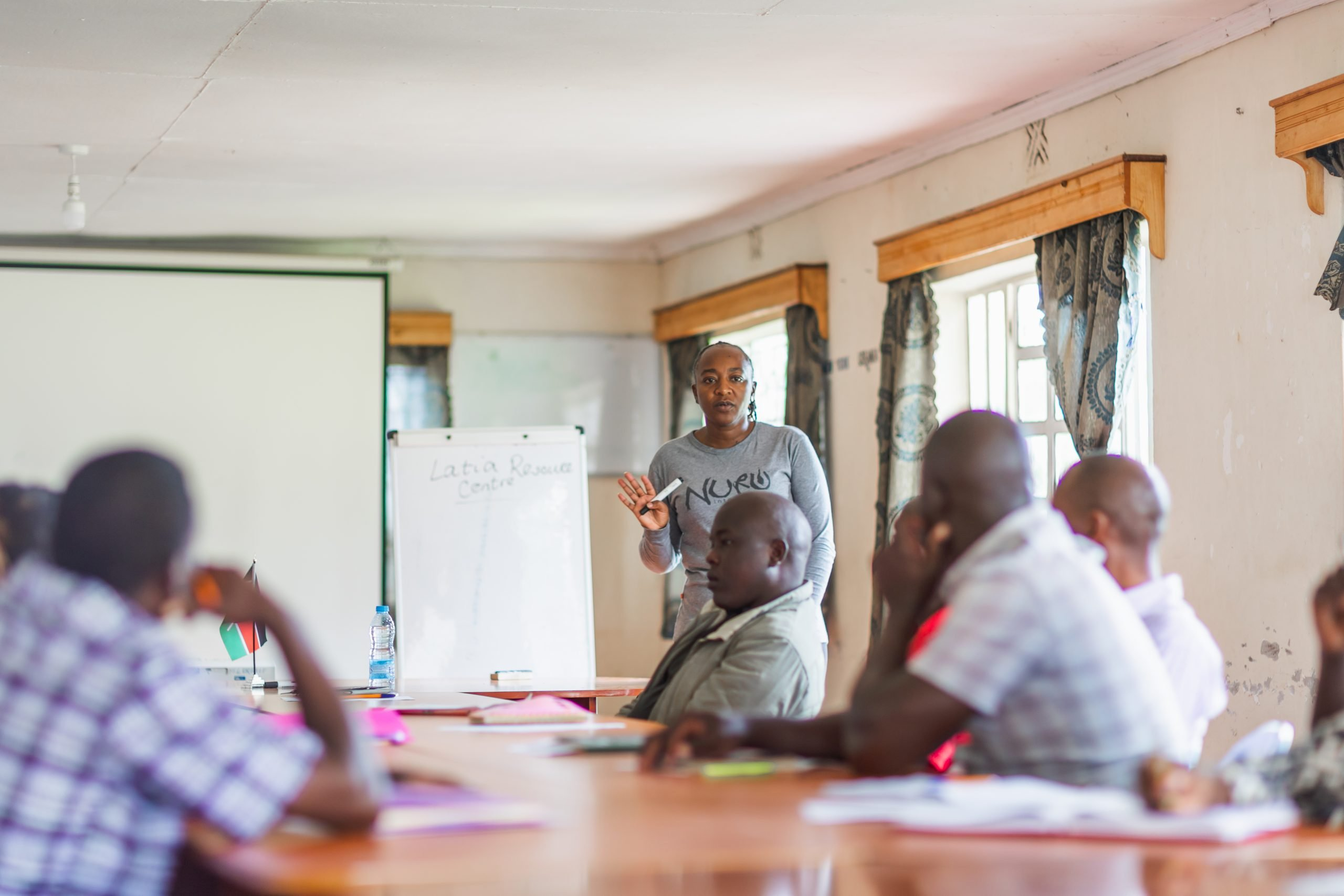 woman leading meeting in conference room in Kenya
