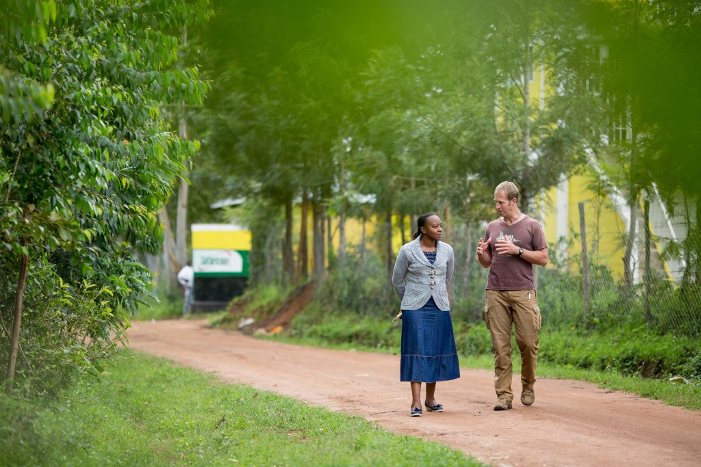 two people walking down a road