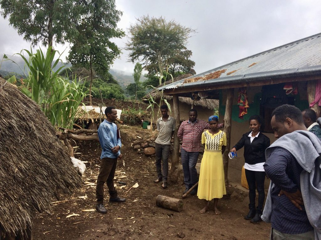 group of people standing outside home in Ethiopia