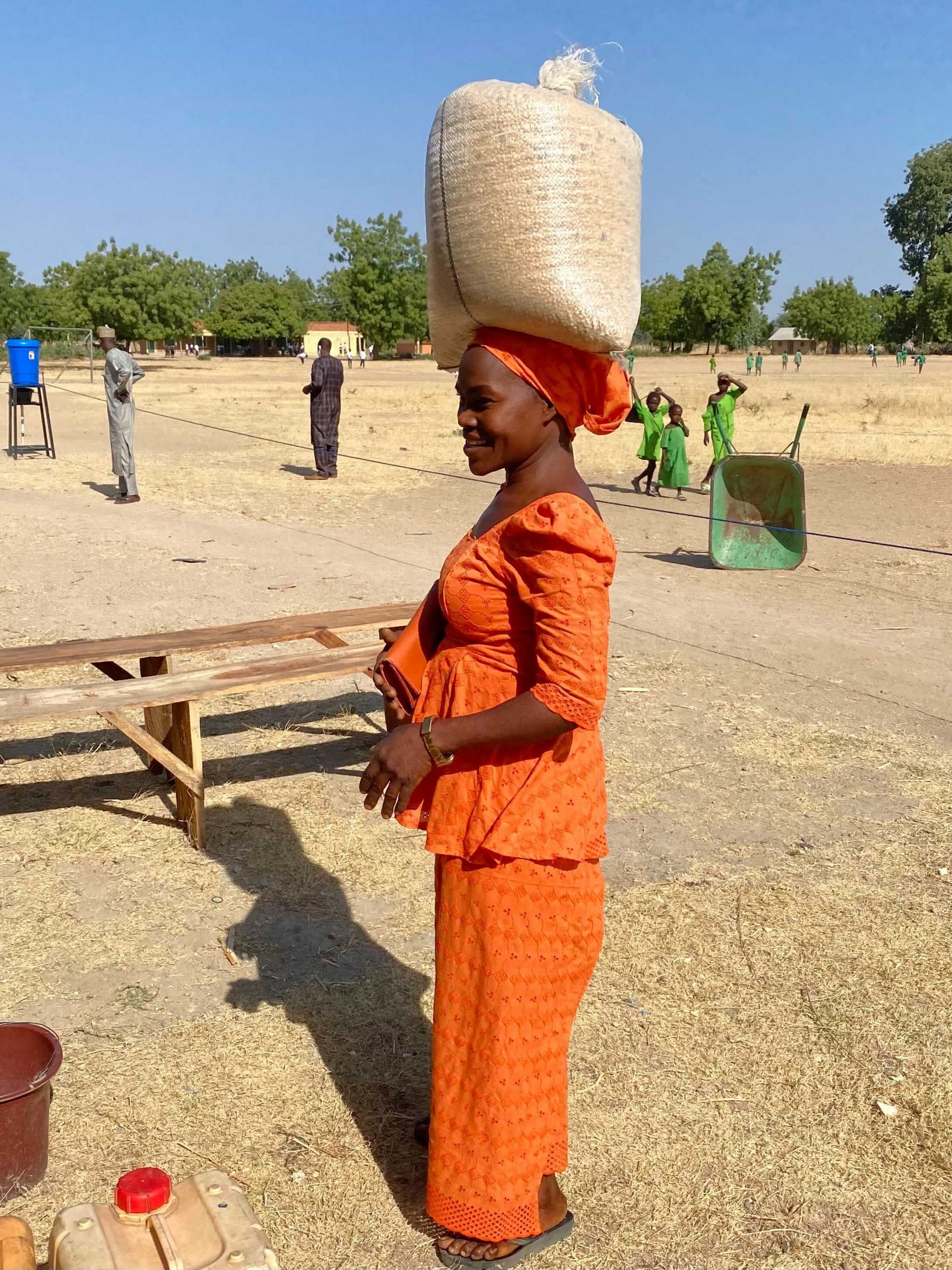 woman carrying grain on her head