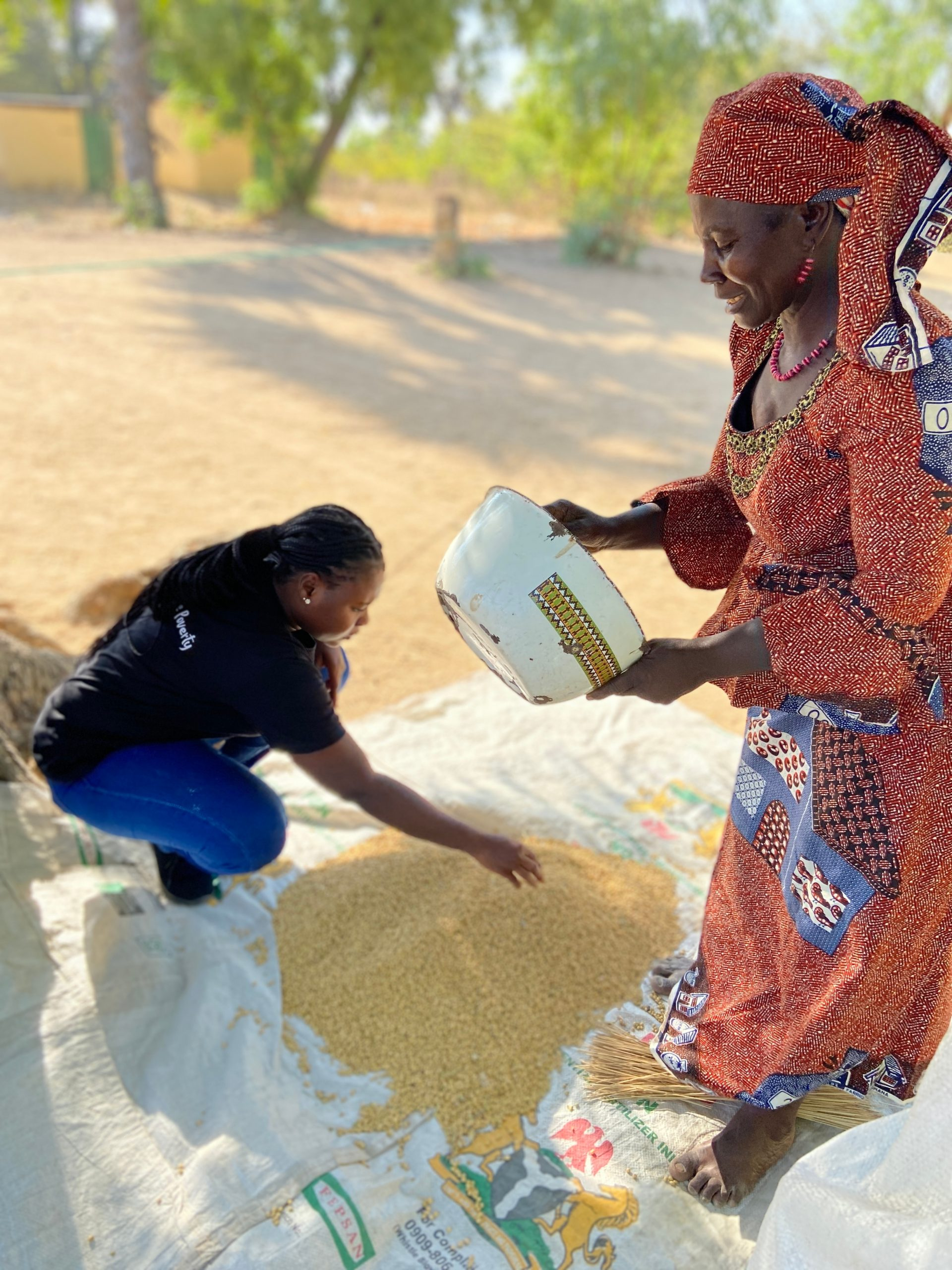 women separating grain outside