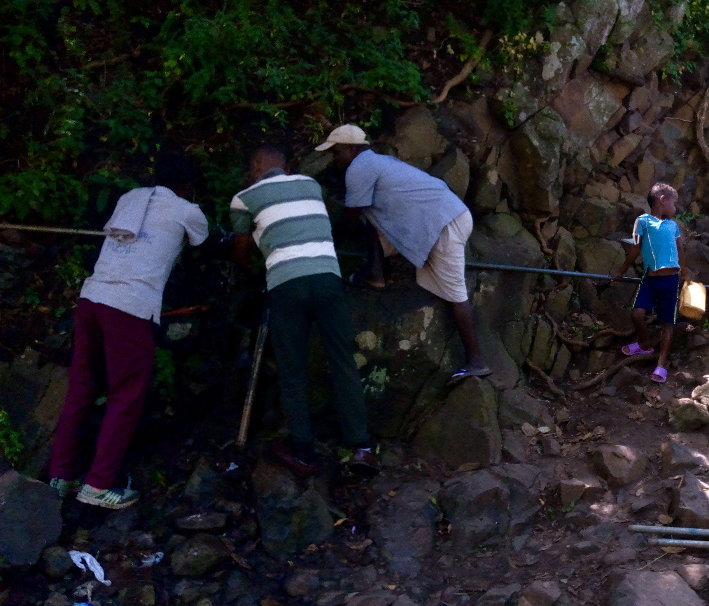 people repairing water source in Ethiopia